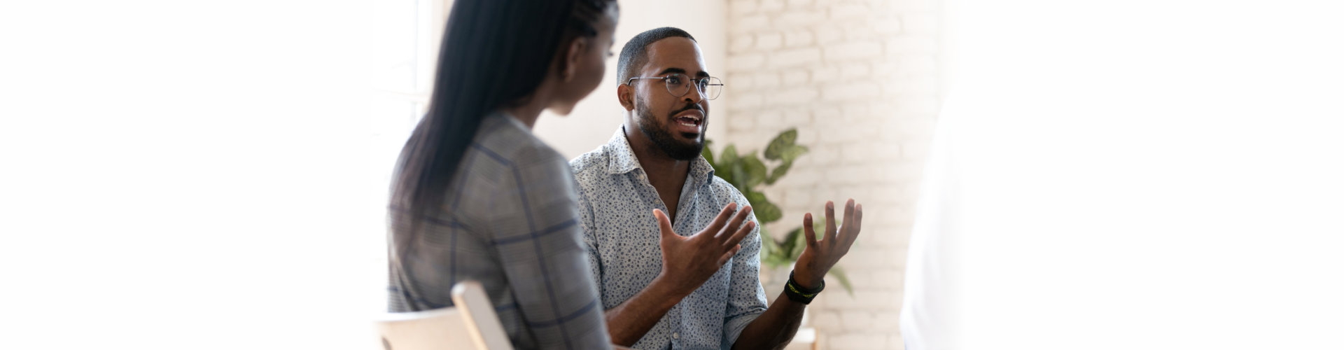 african american male psychologist meeting patients at group therapy.